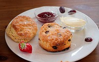 English tea time. Scones with jam and tea.