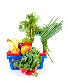 Shopping basket filled with healthy grocery over white background