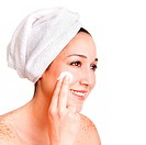 Beautiful happy smiling woman face applying exfoliating cream as anti_aging skincare treatment at spa, isolated.