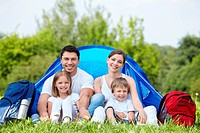 Family outdoors in a tent