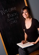 Pretty Teacher in front of the Black Board
