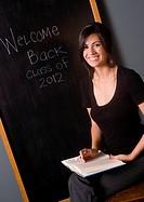 Pretty Teacher in front of the Black Board