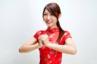 Oriental girl wishing you a happy Chinese New Year