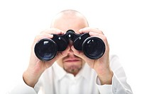caucasian man hold binocular in his hands selective focus image