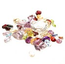 A handfull of mixed genuine gemstones isolated on white.