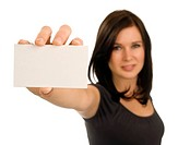 A brunette woman holds a blank, horizontal, business card at arm´s length. Focus is on the card, with face out of focus.