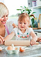 Lucky woman baking cookies with her daughter in kitchen