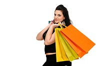 Sexy woman in black dress with colorful bags isolated in white