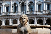 Venetian Contarini fountain, public Library Palace in background, old square, Bergamo, Lombardy, Italy
