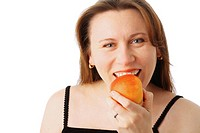 Closeup portrait of a young pretty woman eating a red apple, isolated over white background
