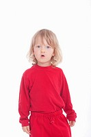portrait of a boy in red with long blond hair - isolated on white