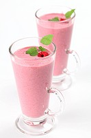 Fresh raspberry milk shake in a glass. Shallow DOF