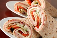 Delicious and healthy wholemeal tortillas with ham, cheese, tomatoes, cucumber and cabbage