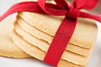 Heart shaped cookies with red ribbon on cloth