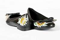 black women shoes with printed flower on white background