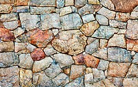 Texture _ a wall made of natural rough stone