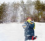 Portrait of a happy child outdoor playing with snow