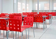Industrial interior furnished in red chairs and silver tables