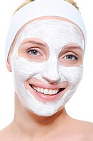 Portrait of happy beautiful young woman with cosmetic mask on her face _ isolated