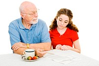 Grandfather explains the democratic process to his teen granddaughter. Isolated on white.