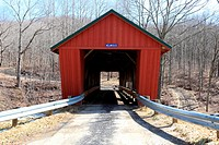 Facade of Helmick Mill Covered Bridge. It was built in 1867. It has a multiple Kingpost truss and is 74 feet long. Ohio, USA
