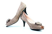 Woman brown shoes on the white background
