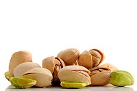 Extreme close_up image of pistachios on white background