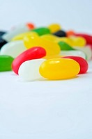 Close up of brightly coloured jelly beans with copy space above and below. Portrait orientation.