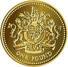 British money gold coin one pound with the image of a heraldic lion, unicorn, shield and crown, isolated on white background