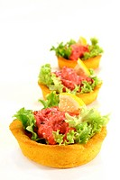 Corn cakes with salmon salad on a white background