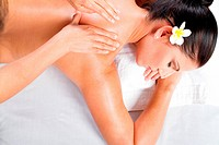 overhead view of young woman receiving back massage in spa