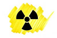 Radioactivity symbol in black on yellow ink marker scribble.