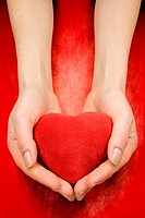 hands with heart on red grunge background