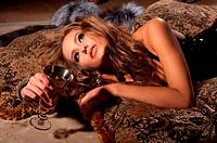 beautiful brunette woman lying on a fur mat