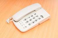 White office phone on the flat surface