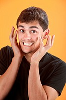 Uncontrollable joy for Latino teen on an orange background