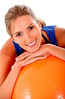 Sportive woman with a pilates ball _ isolated over white