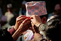 Groom having tikka applied by his family at a Nepalese marriage ceremony, Pokhara, Nepal, Asia