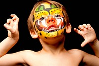 young child with face painted as a Jaguar