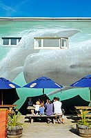 Restaurant and cafe, mural painting of whales on the facade, town centre of Kaikoura, South Island, New Zealand