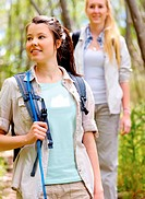 two beautiful attractive woman hiking outdoors in the woods. healthy active lifestyle concept