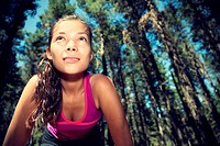 Runnner. Woman running in forest taking a break from working out. Beautiful young female athlete _ copy space.