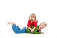 two young siblings fooling around with each other - isolated on white