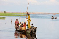 Boat with passengers, near Ganvie lake village on Nokoue Lake, Benin, West Africa, Africa