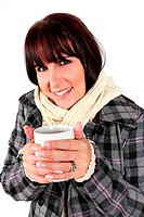 Lady holding a cup of coffee wearing winter clothes
