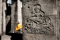 Stone carving of dancing girl on temple ruins