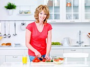 Beautiful woman preparing healthy food in the kitchen _ indoors