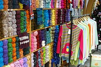 Yarns and clothing for sale in a small fabric shop. Sao Miguel, Azores islands, Portugal
