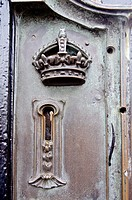 Close-up of the keyhole in the iron gate surrounding Buckingham Palace, London