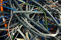 A messy pile of used cables